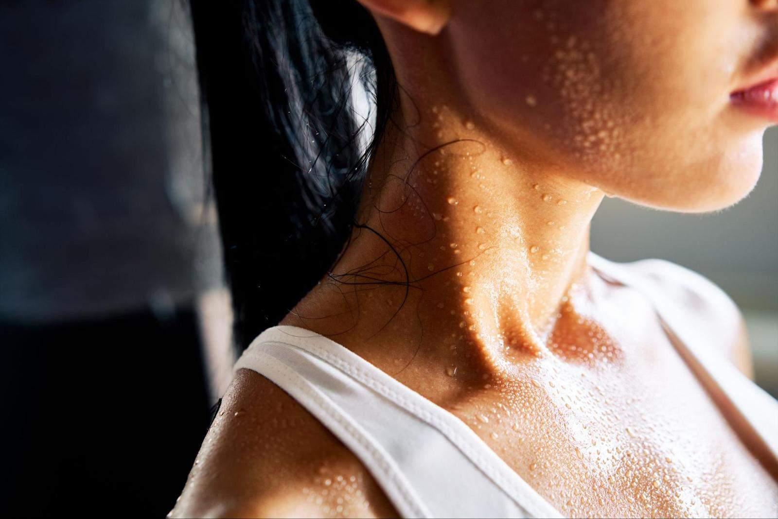 infrared sauna benefits and disadvantages: woman perspiring